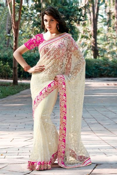 Specifications : Fabric Details Material Net Length 6.3 Mtr Blouse Art Silk(Un-Stitched) General Details Work Embroidery Hand Work Type Saree Occasion Party