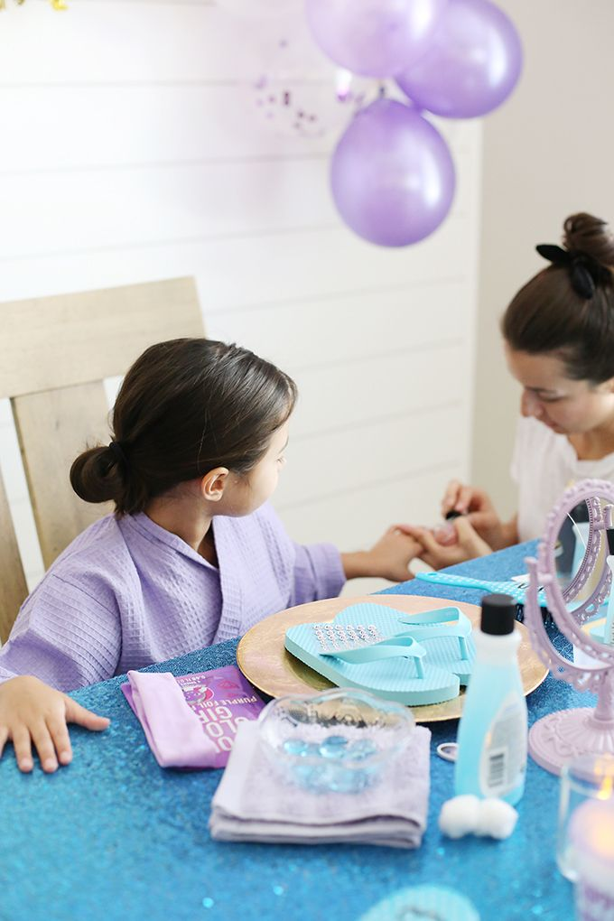 At Home Unicorn Spa Birthday Party - Kids spa party, Spa birthday parties, Spa birthday, Girl spa party, Spa party, Girls birthday party - Plan an at home unicorn spa birthday party for girls with these tips and tricks! Do pedicures, manicures, facials and offer a braid bar  Kids will love it!