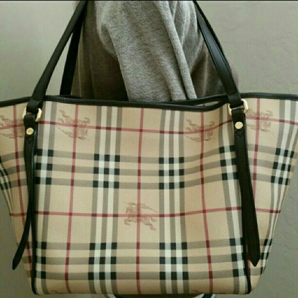 """Authentic Burberry Tote Bag NO LOW-BALL OFFERS!!  Guaranteed AUTHENTIC!  Burberry Haymarket Canterbury Tote Bag Originally paid almost $1000 with tax.  *One side has spots of FADED/LIGHTER denim/dark color transfer (see pic #2).  *Interior is clean.  *USED but in EXCELLENT condition, signs of wear from normal use.  *PVC with brown leather trim & straps *Approx dimensions: 11"""" H x 12.5W/18""""open x 6.5""""D *Made in Italy *TOTE ONLY SOLD AS-IS and FINAL! Burberry Bags Totes"""