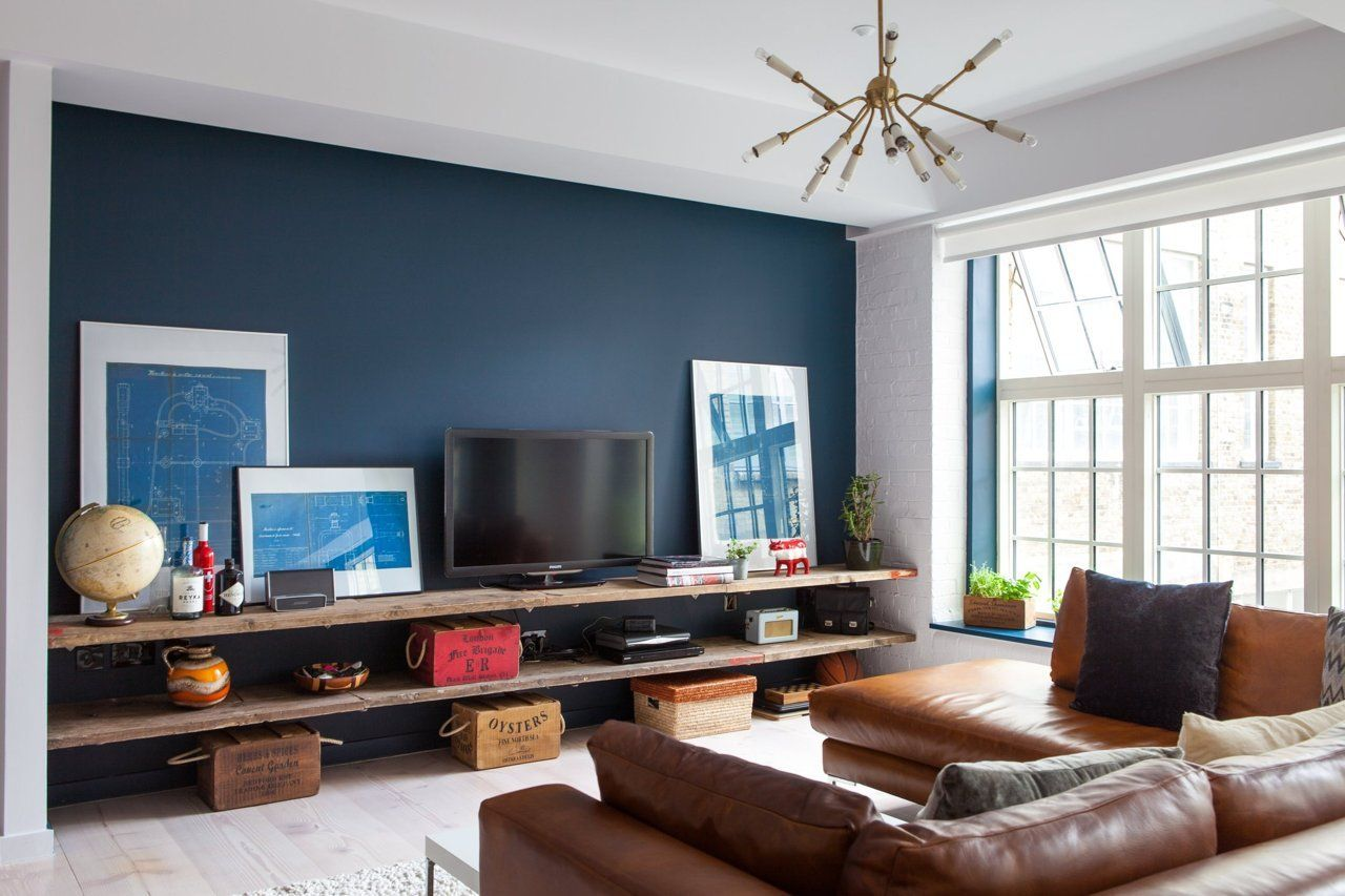 Audrey S Cozy Industrial Soho Apartment Blue Accent Wall Living Room Feature Wall Living Room Accent Walls In Living Room