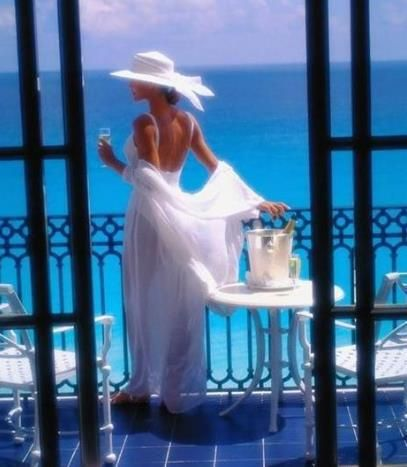 Miss Glam is upstairs at the Beach House looking out over the deck.  I think the champagne has been opened already, what time is it? 2:00pm? I love her way of life............
