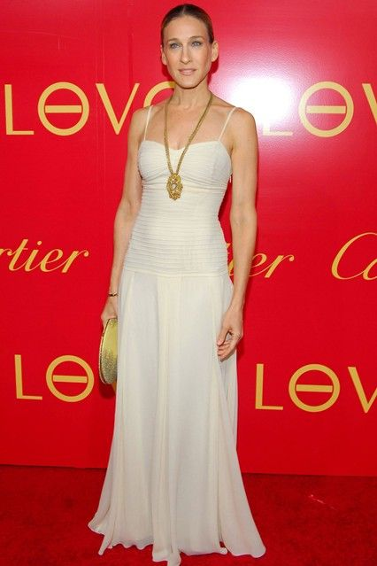 In a full-length white dress at a Cartier party in New York.