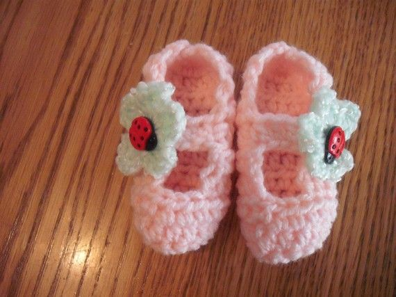 Light pink baby bootie with light green flower and by HaughtTot, $6.00