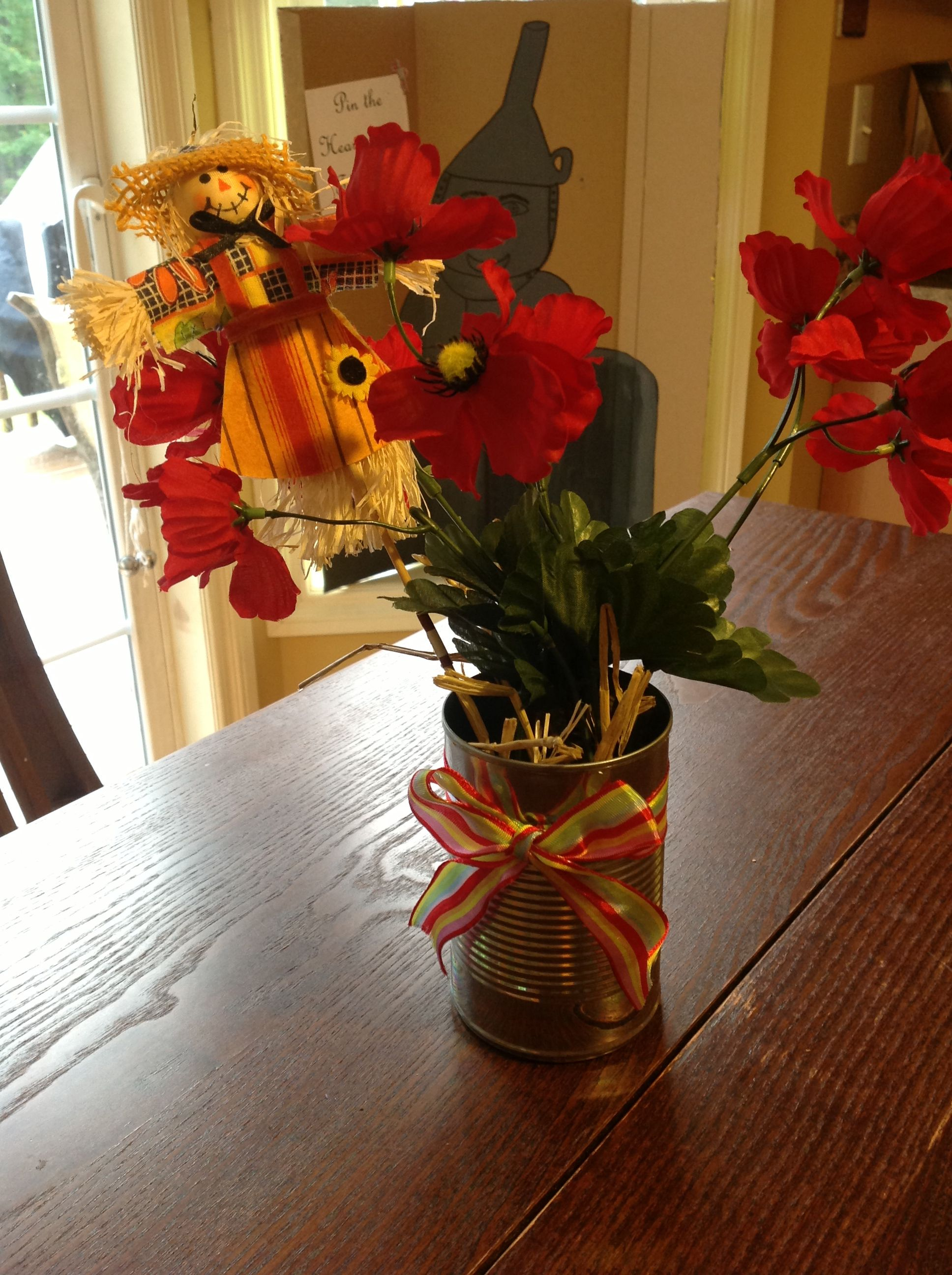 Wizard of oz poppy in a tin can with straw centerpieces ...