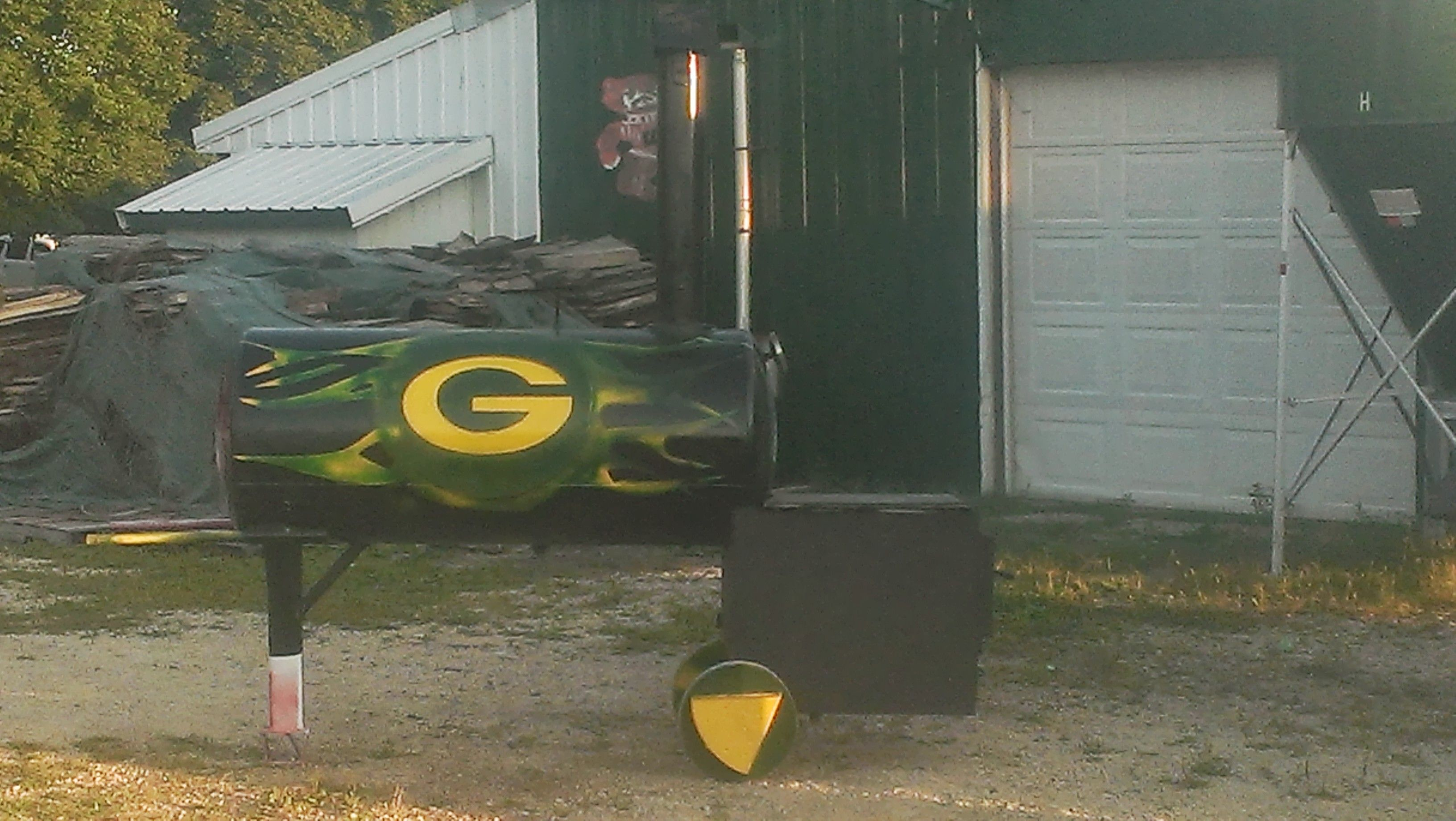 Green Bay Packers Themed smoker I just finished building, Packers from this side, and U of W from the other, so cool.