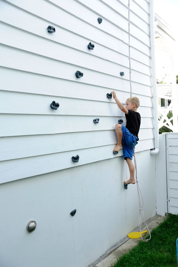 A kids climbing wall on the side of a house! Love it! not sure