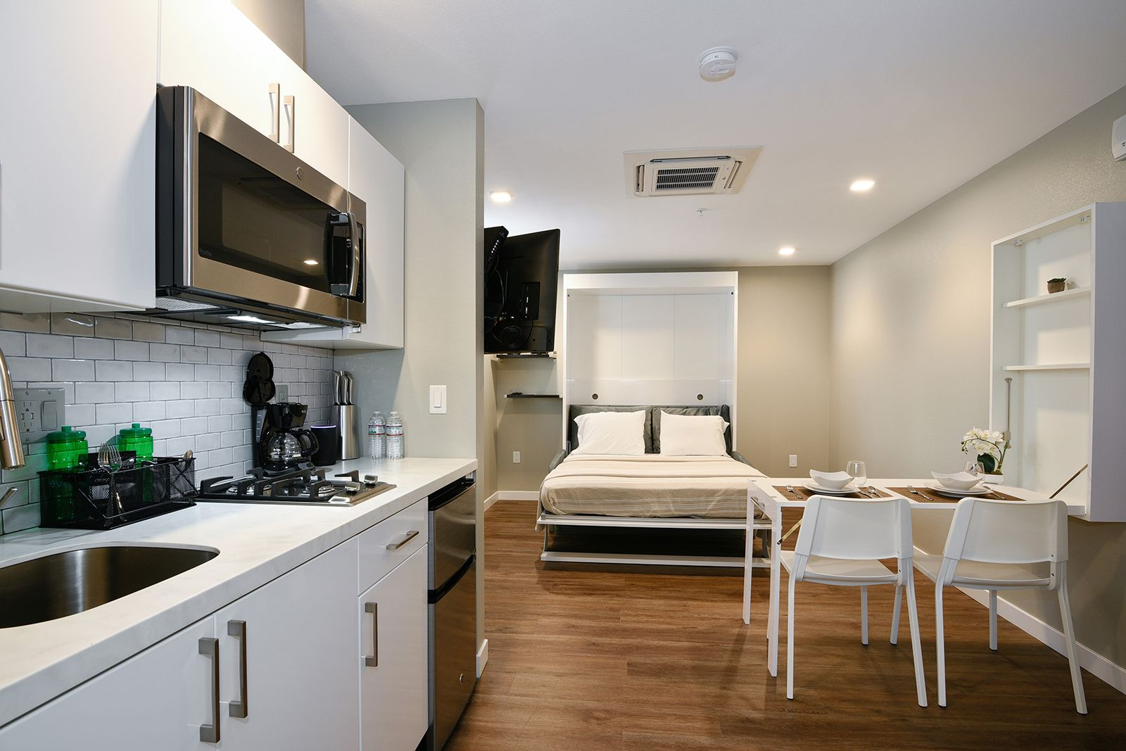 Our Fully Furnished Studio Apartment Homes Feature Renovated Interiors With High End Appliance And Furni Apartments For Rent Chair Design Furniture Arrangement