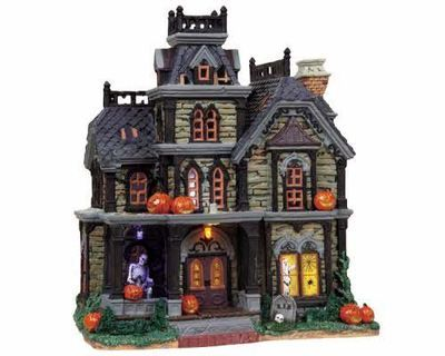 The Haunted House. No spooky Halloween Village could be without one of these. It has rushing wind, screams, hot and cold chills, maniacal laughter and lightning. Zap!