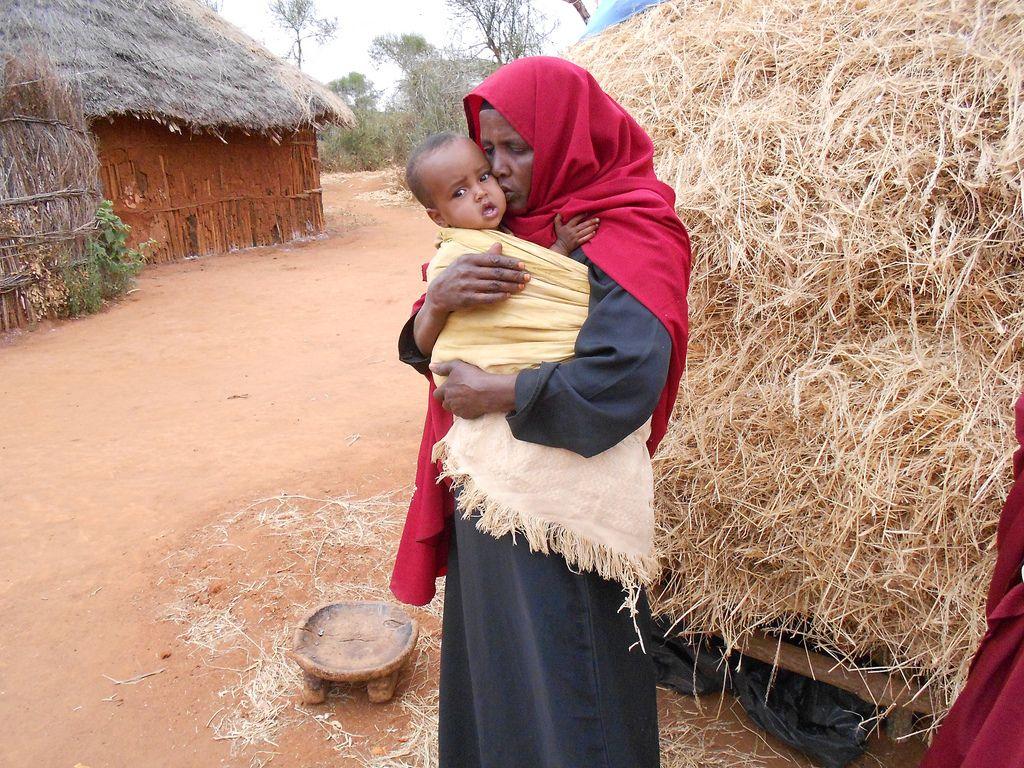 Somali mother and malnourished child in a Kenyan refugee camp  (Save The Children, flickr)