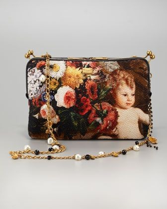 Miss Angie Angel Shoulder Bag by Dolce & Gabbana. The embroidery,the angel, the floral pattern,the strap adorned with beads, the clasp, the interior, the pockets to hold modern day accessories makes this bag absolutely perfect! Bravo!!!