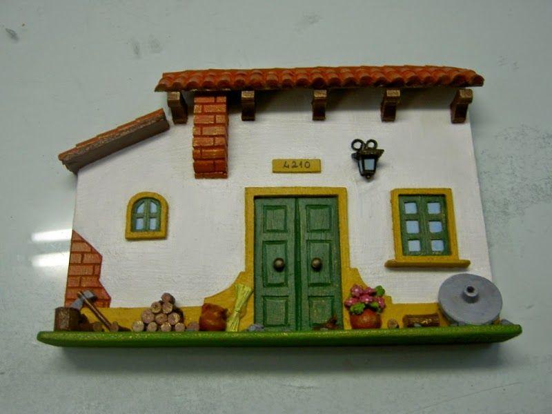 ABruxinhaCoisasGirasdaCarmita: Casinha em barro (pintada)