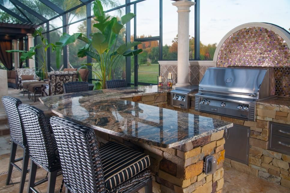 the chef is never far from the grill or the company while cooking in this luxurious ou on outdoor kitchen natural id=53825
