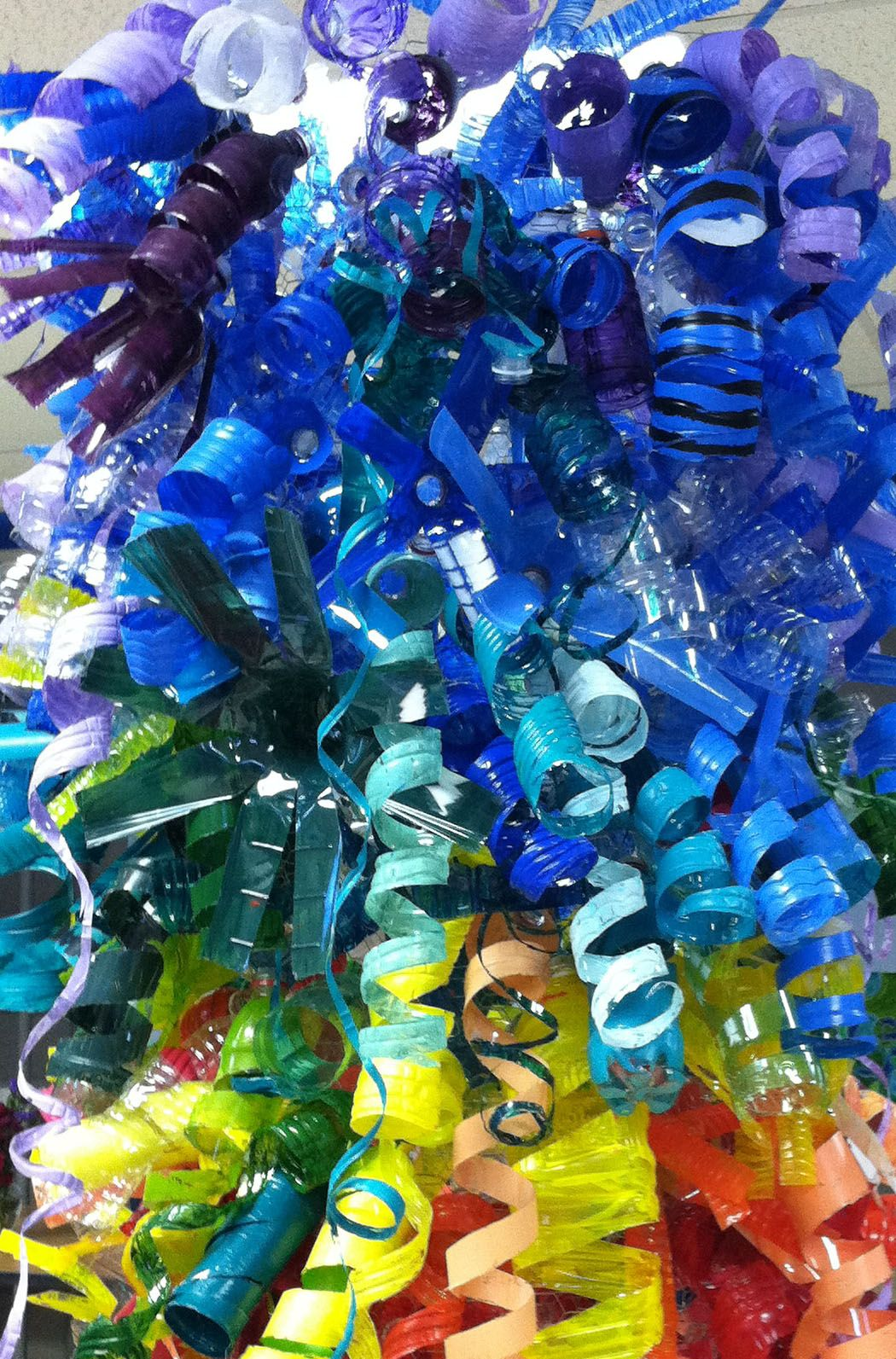Painted plastic bottle hanging sculpture art i love for Art made from plastic bottles