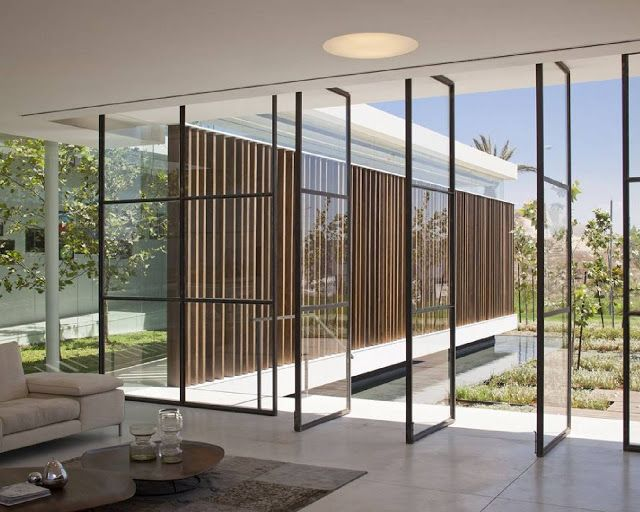Gindi holdings sales center by pitsou kedem architects for Center sliding patio doors