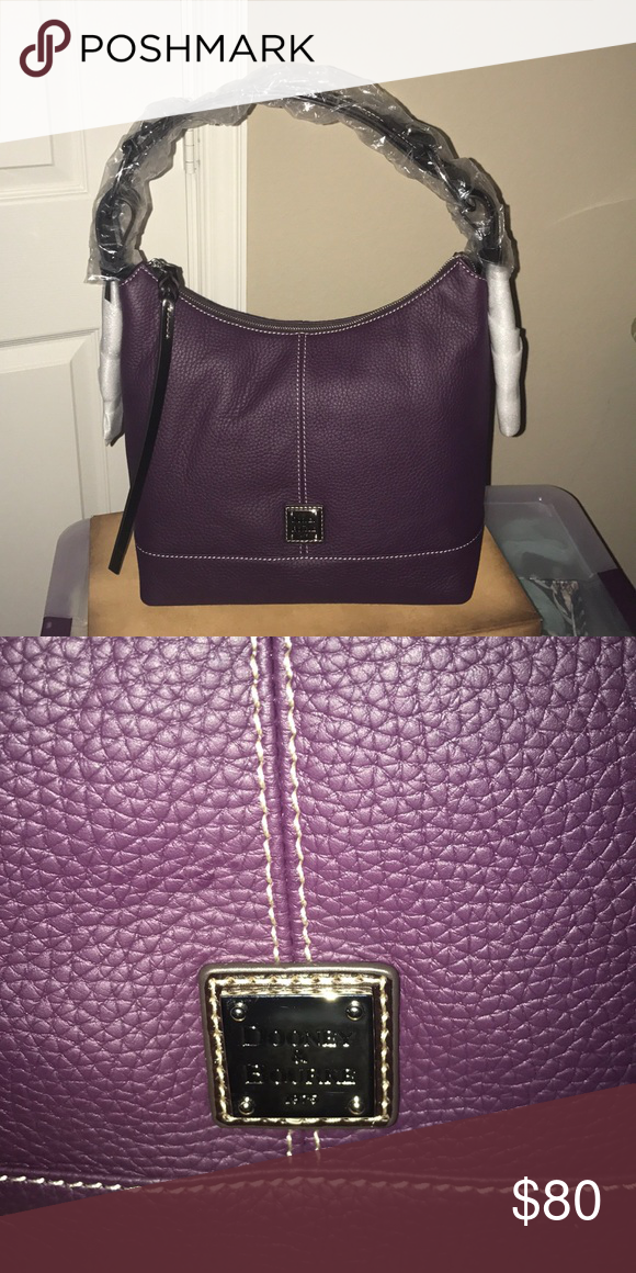 c24cd3823d Gracie Dooney   Bourke purse New never used. Plum wine Gracie purse Dooney    Bourke Bags Shoulder Bags