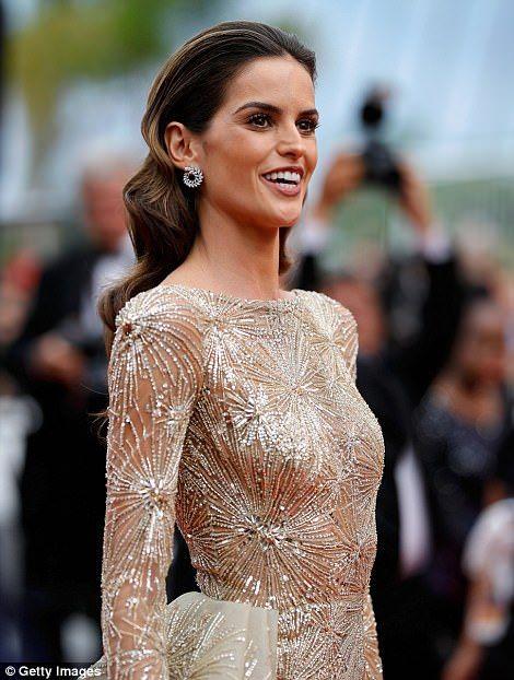 Glorious: Brazilain model Izabel Goulart left little to the imagination in a sheer floor-length dress