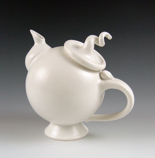 Ceramic Teapot - Wheel-thrown and hand-built glazed porcelain teapot. Food and dishwasher safe.<br><br> <b>Dimensions:</b><br>8.25H, 8.75W, 5.75D.