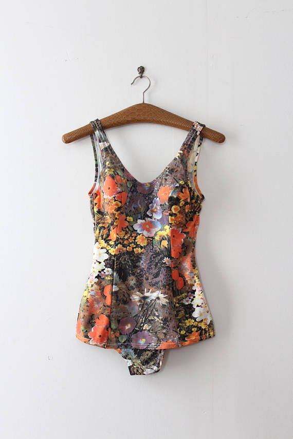 Unique vibrant floral swimsuit from the 1960s. Label: Young Cosmopolitans