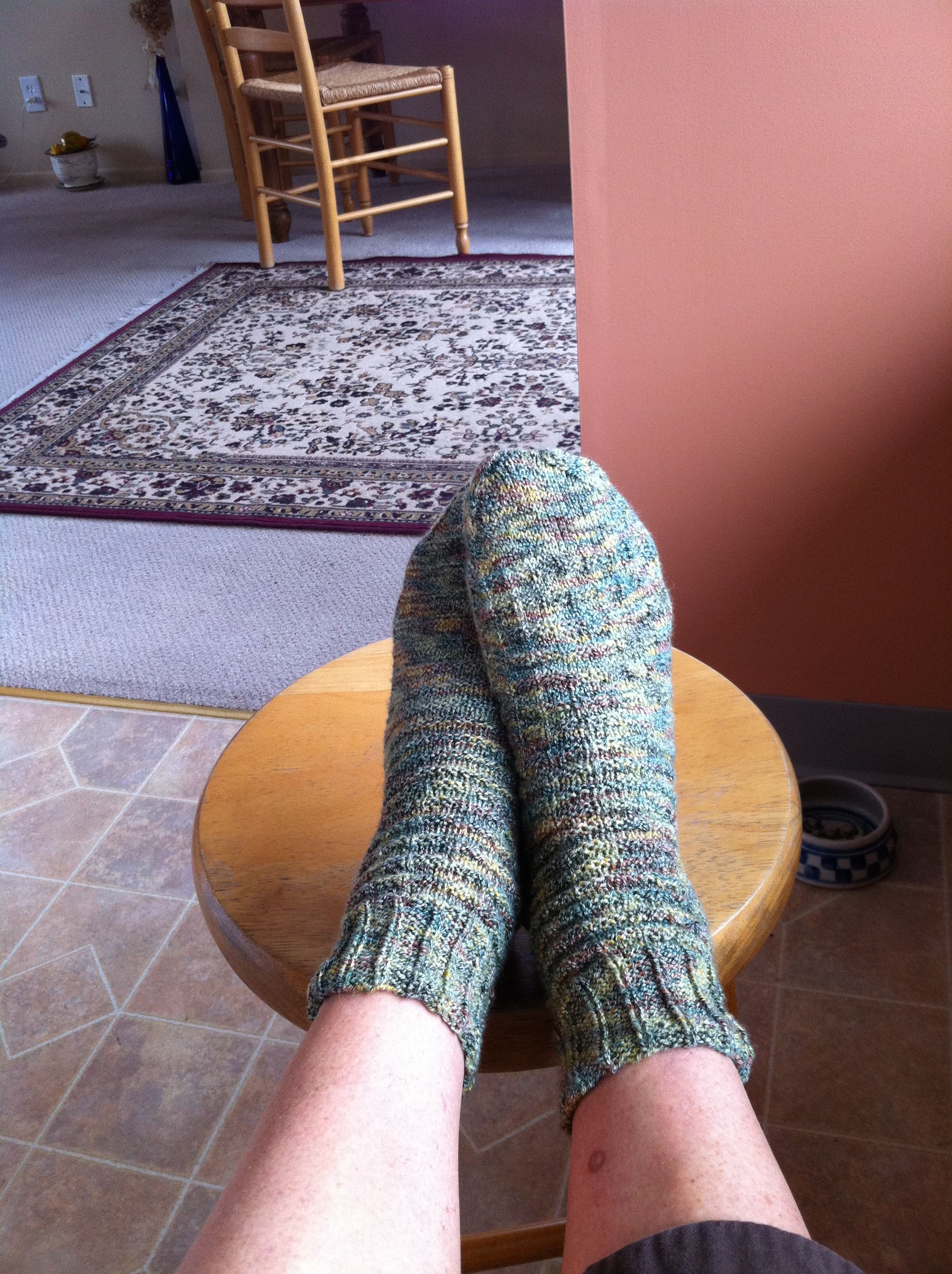 My first pair of hand knit socks. One was a bit bigger ...