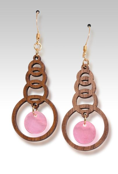 Walnut rings with pink capis shell  $12.95  from Woodies - Gecko Graphics, Inc.
