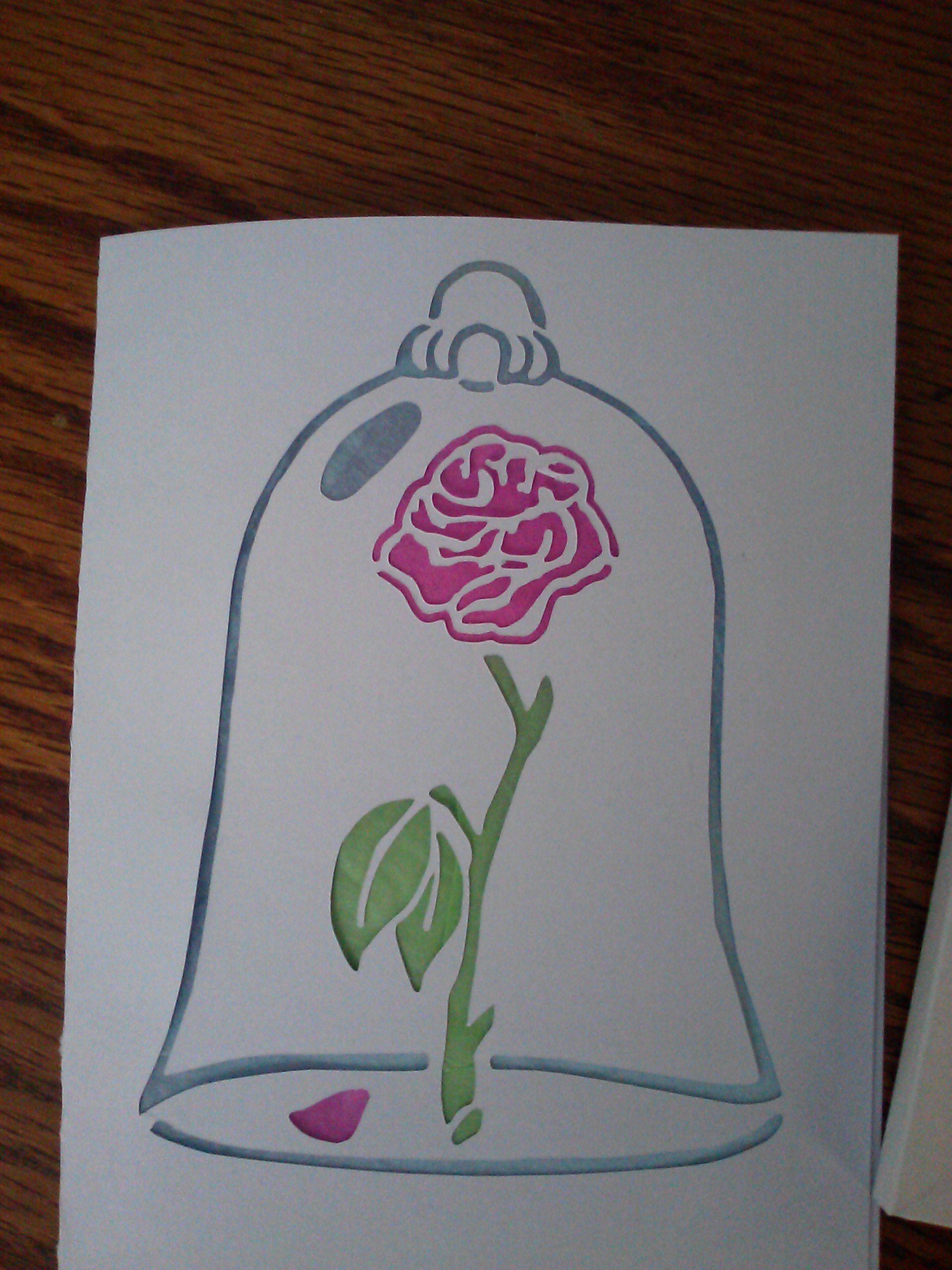 Beauty and the Beast rose Silhouette birthday card with colored tissue paper behind the cuts