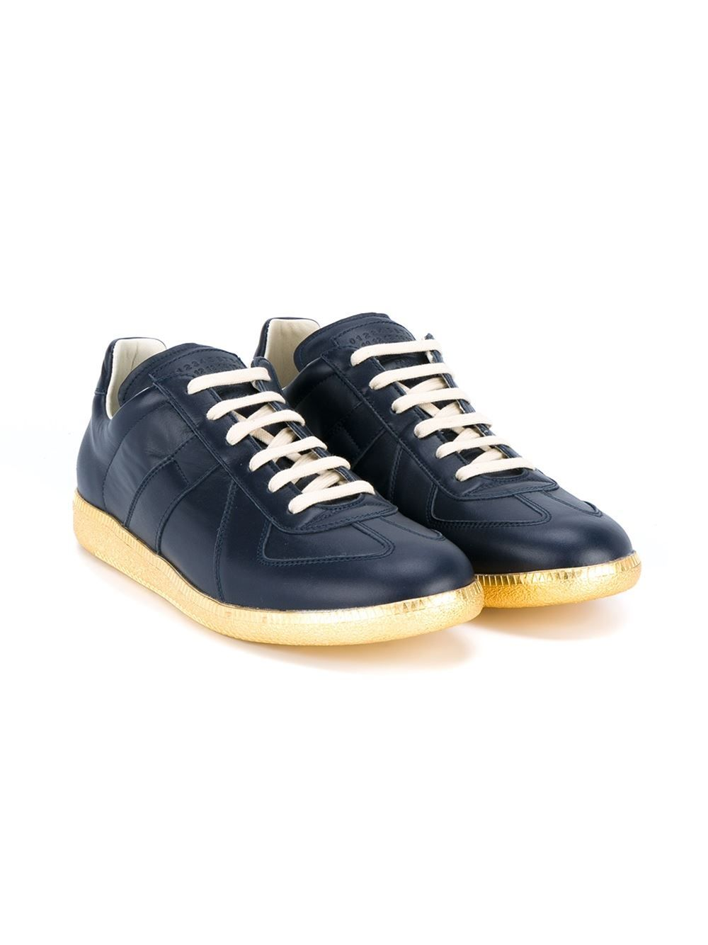 625340e04a0 These navy Maison Margiela  Replica  leather sneakers inspired by men s  70 s sports shoes