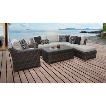 Michal 4 Piece Rattan Sectional Seating Group with Cushions
