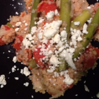 Tonight's dinner vegetarian cous cous with tomatoes,cauliflower,asparagus and feta.yum