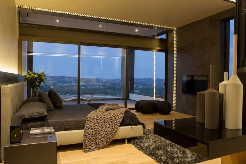 Contemporary masculine bedroom with a view