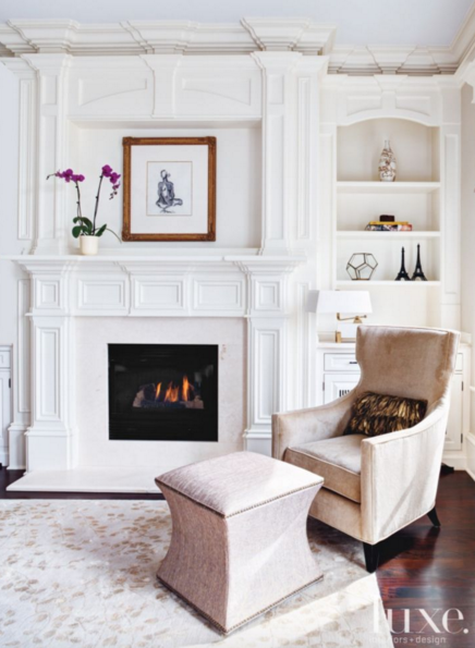 "Luxe Magazine on Twitter: ""In this living room, a cozy chair sits by a fireplace with a matching foot stool & pillow: https://t.co/1ngqFcj7Ek https://t.co/3s4hbQoIRq"""