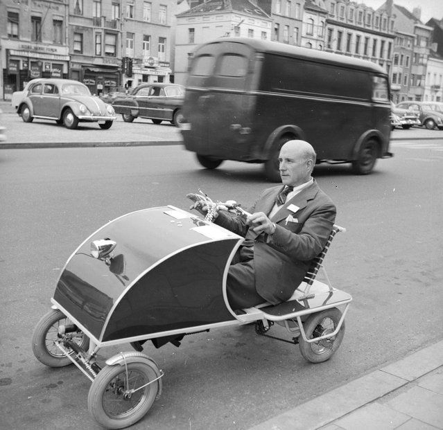 Fernando Ruiz Luciarte driving his invention, the Oto-Pedal, through the streets of Paris, July 1958. The car, specially designed for elderly people, is modelled on the child's pedal car and travels at a speed of 25 miles per hour. (Photo by Karel Berg/BIPs)