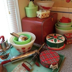Jadeite, Pyrex and Fire King dishes in red, white and green with vintage Christmas and tartan tins.  #retrokitchen #vintagekitchen