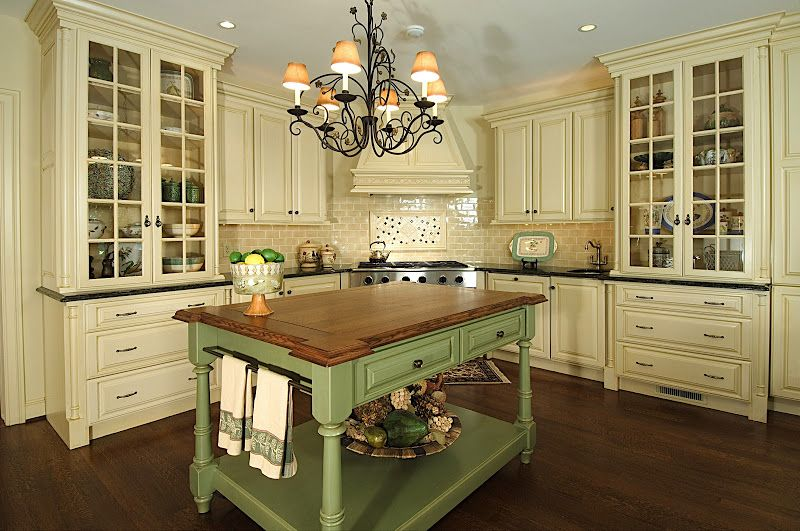 Cream cabinetry, green island