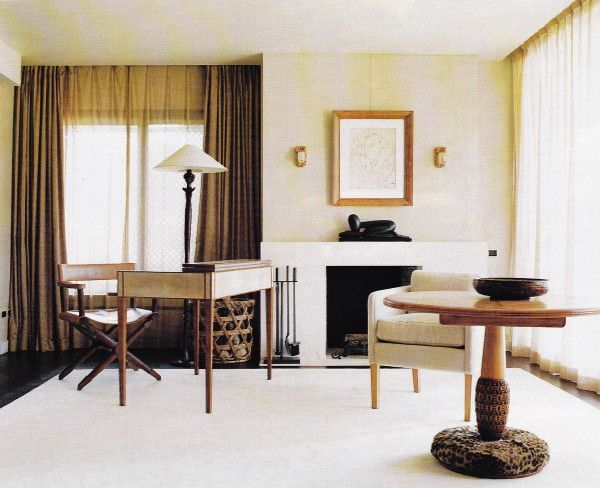 The desk in the master bedroom of Villa Nara Mondadoi designed by Peter Marino is by Jean-Michel-Frank; the table and sconces are by Armand Albert Rateau.