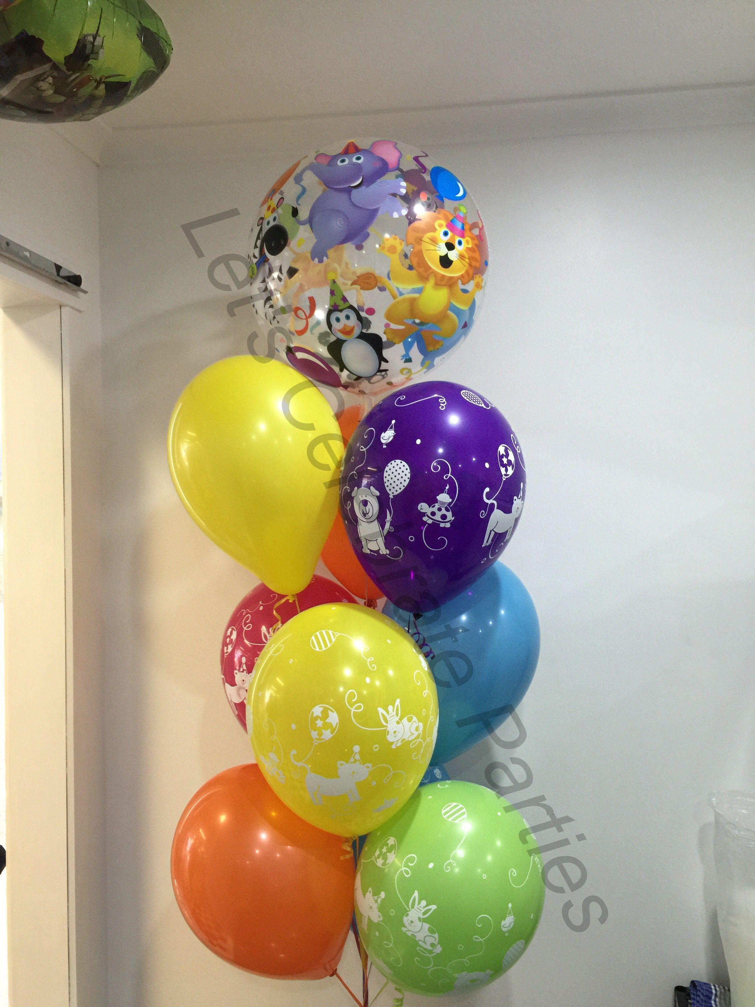 Animal balloon decoration using a balloon bubble, printed and plain ...