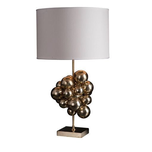 This striking polished brass table lamp is entirely handmade and decorated with spheres of different diameters welded together