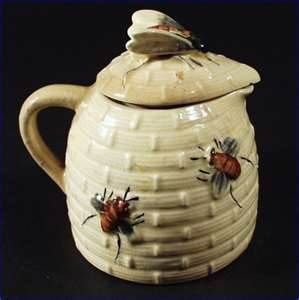 bee hive jug with lid.