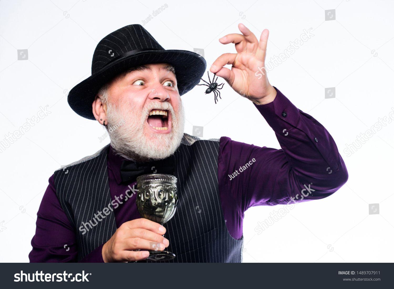 Elegant bartender wear hat and vest. Halloween concept