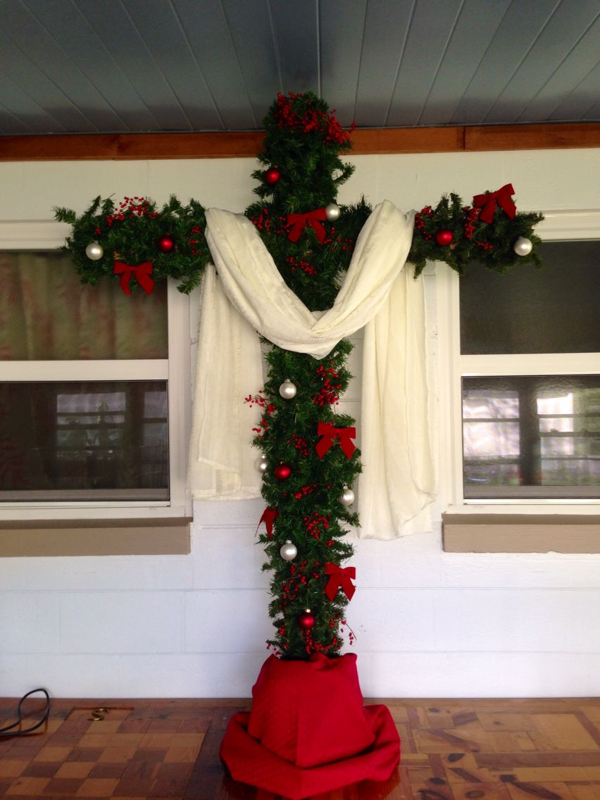 our cross christmas tree made with rough hewn cedar boards and garland we kept the decorations red and white representing our sin and the purity of jesus - Cross Christmas Tree