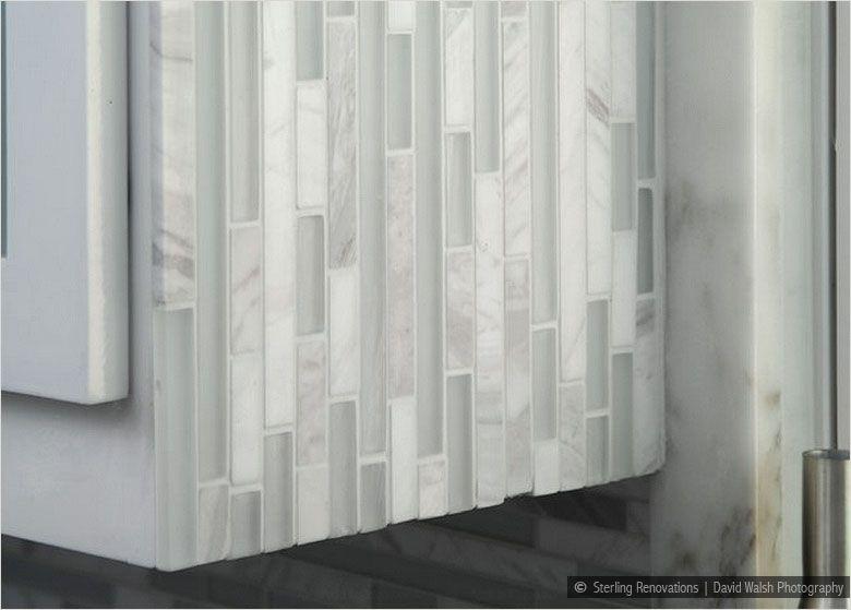 glass marble white backsplash tile installed vertically in shower