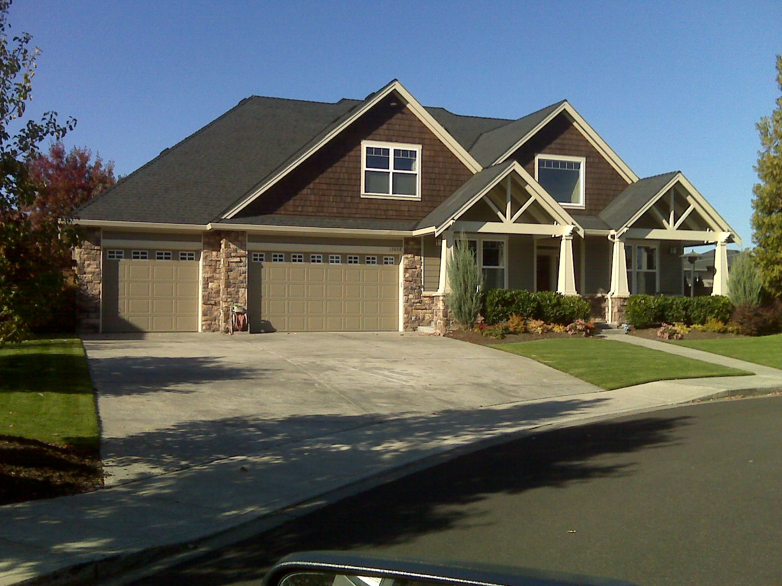 A possible option for over the front door craftsman style Triple car garage house plans