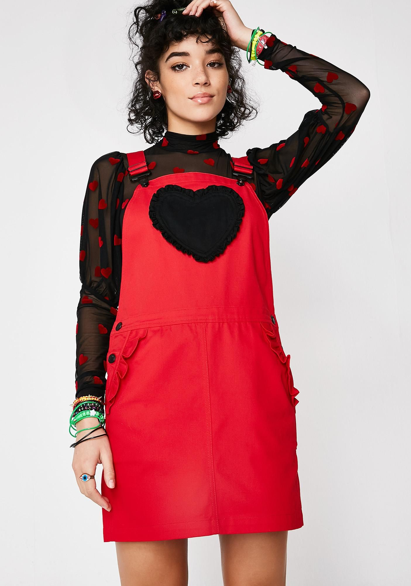 9b130bd97fd Lazy Oaf Frilly Heart Pocket Pinny Dress cuz you re all in your feelz. Keep  it cute af with this denim overall dress that has a black heart patch pocket  on ...