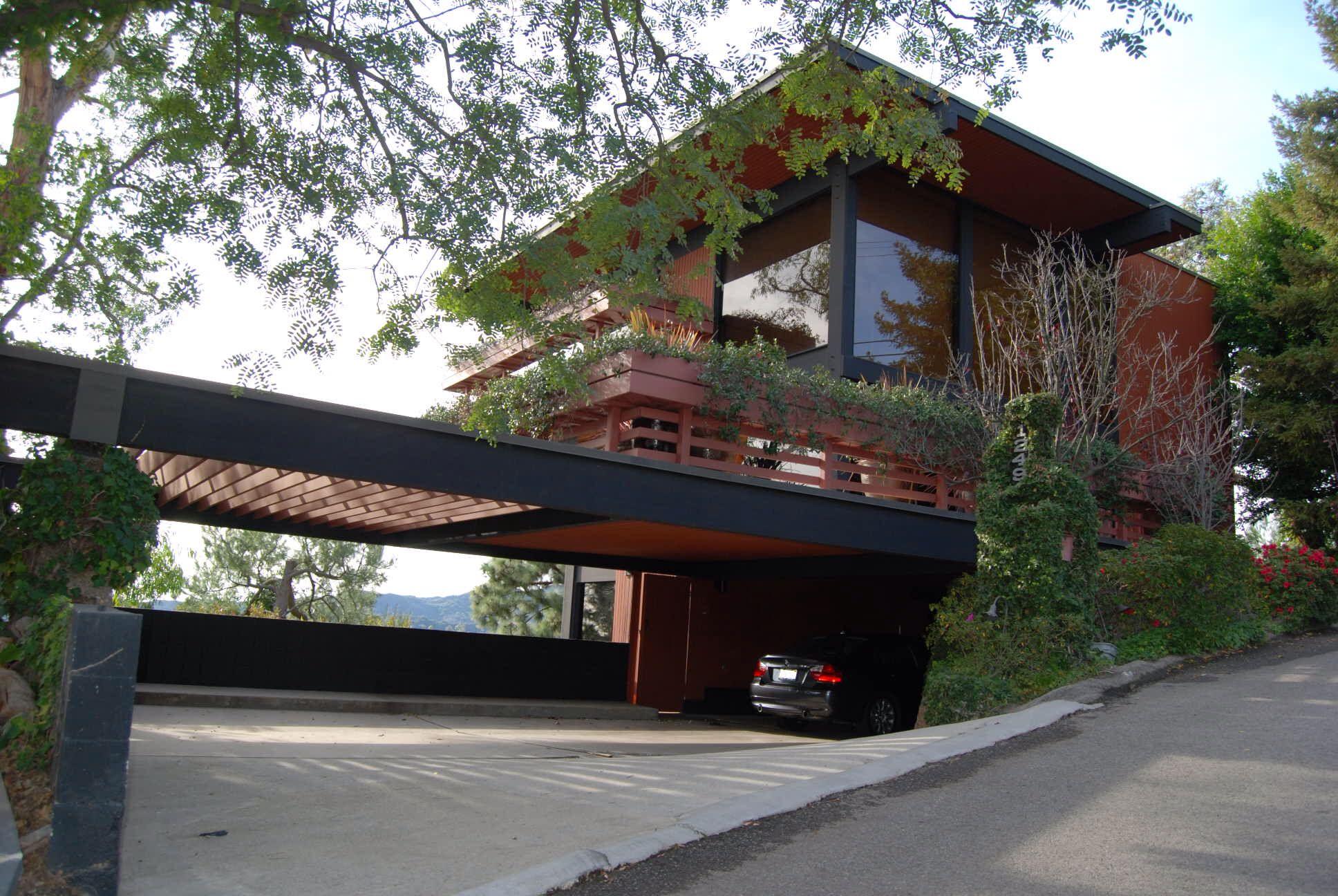 Svelte modern home featuring a carport