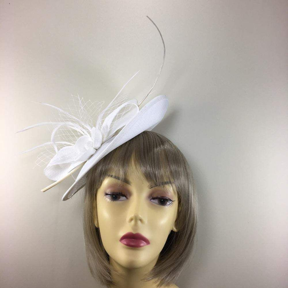 4df4b920f72 Feathers · Headbands · A graceful saucer style fascinator hat in white  designed with a saucer fascinator base and decorated