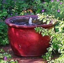 How to make an outdoor fountain from a pot.