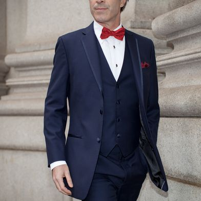 515335e42edd Tonight's winning look is a navy tuxedo with a red bow tie and pocket  square to match. #JosABank