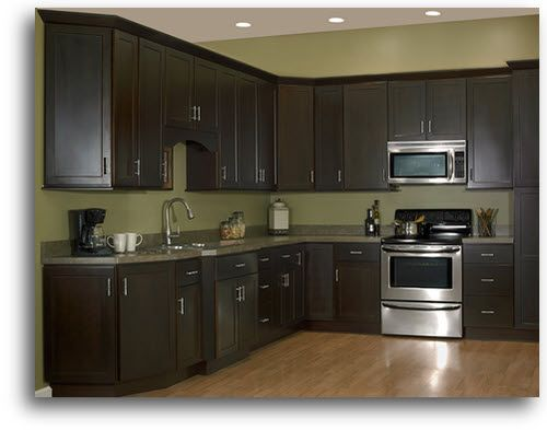 Dark cabinets and green walls