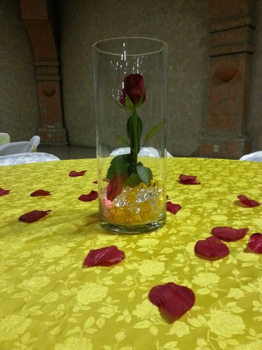 Simple single red rose centerpiece quinceañeras ideas