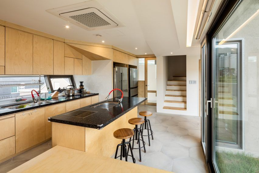 View of the lower floor kitchen within Busan Times by Moon Hoon
