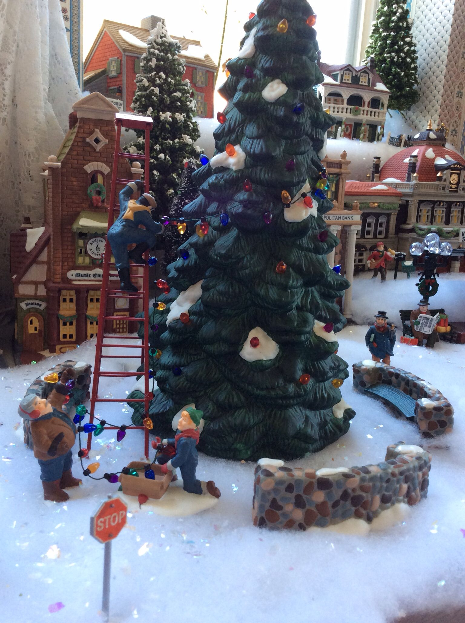 Christmas Village Dept. 56 - trimming the tree